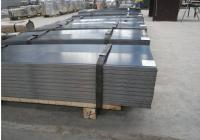 A picture of steel sheet metal on pallets.